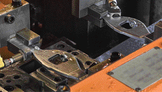 precision rocker arms move through a high-speed transfer press