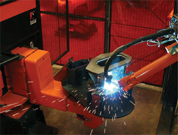 A servo-controlled arc-welding robot and three-axis positioner form the heart of a new welding cell.