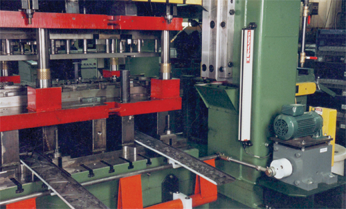 Conveyors removing scrap from a press