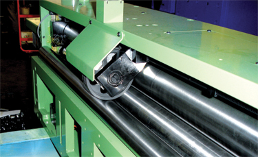 Some compact straightener-feeder heads include a closed-loop measuring wheel