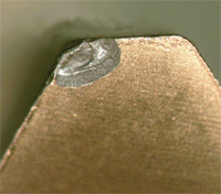 Overly aggressive grinding or EDM machining can cause poor edge retention