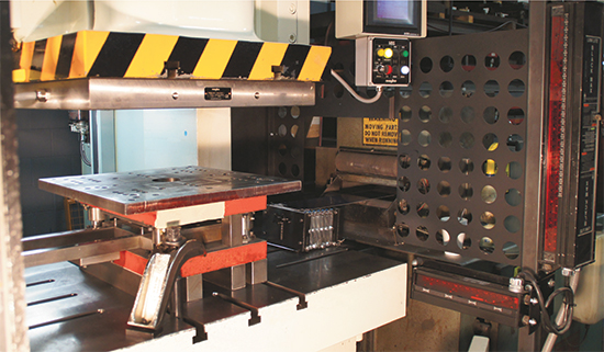 165-ton press with magnetic clamping for the upper and adjustable mechanical clamps for the lower