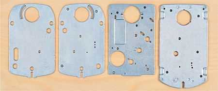 separate but similar die designs were required to produce the four parts shown here