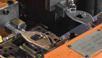 precision rocker arms move through a high-speed transfer press