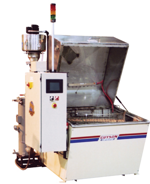 Rotary parts washer rinses and dries