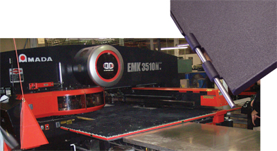 genesis fabricates this hinged door panel on its newest turret press.