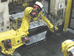 Ford replaced staight-path automation with R-2000 six axis robots