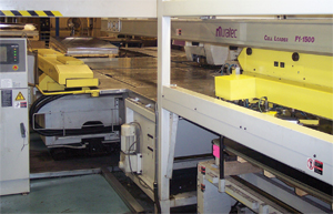 Automated material loand and unload equipment on three of its six CNC turret presses