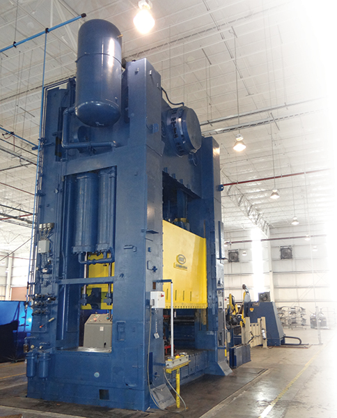 1000-ton press with a rebuilt 60 in. wide capacity feed line with 7.5-hp motor and five-roll straightener