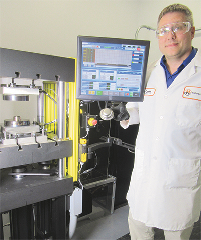Scott Lay inspects advanced high strength steel cup