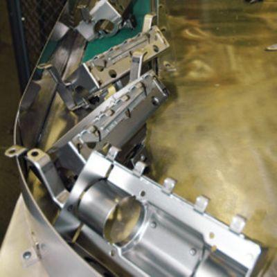 Abrasive Belt, Demagnetizer Prove Key to New Conve...