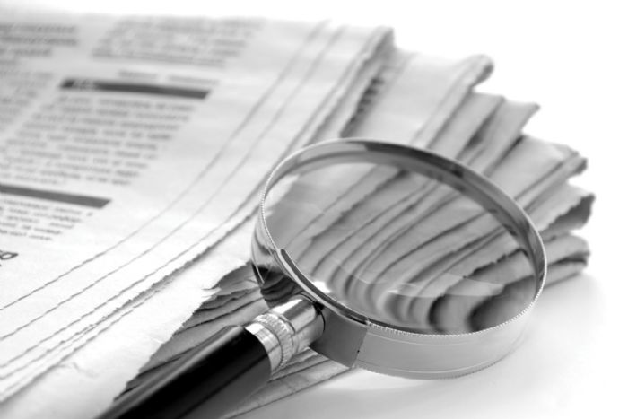 newspaper-magnifying-glass